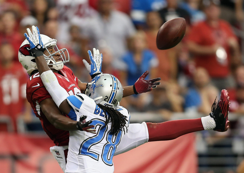 Description of . Cornerback Bill Bentley #28 of the Detroit Lions is called for pass interference on Wide receiver Andre Roberts #12 of the Arizona Cardinals in the fourth quarter at University of Phoenix Stadium on September 15, 2013 in Glendale, Arizona. The Cardinals defeated the Lions 25-21.  (Photo by Jeff Gross/Getty Images)