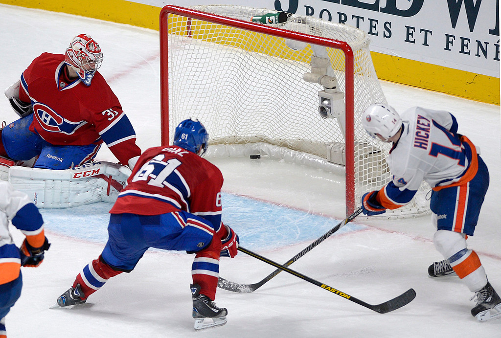 Description of . Montreal Canadiens goaltender Carey Price (31) is scored on by New York Islanders' Thomas Hickey, right, as Canadiens' Raphael Diaz defends during overtime of their NHL hockey game, Thursday, Feb. 21, 2013, in Montreal. The Islanders won 4-3. (AP Photo/The Canadian Press, Graham Hughes)