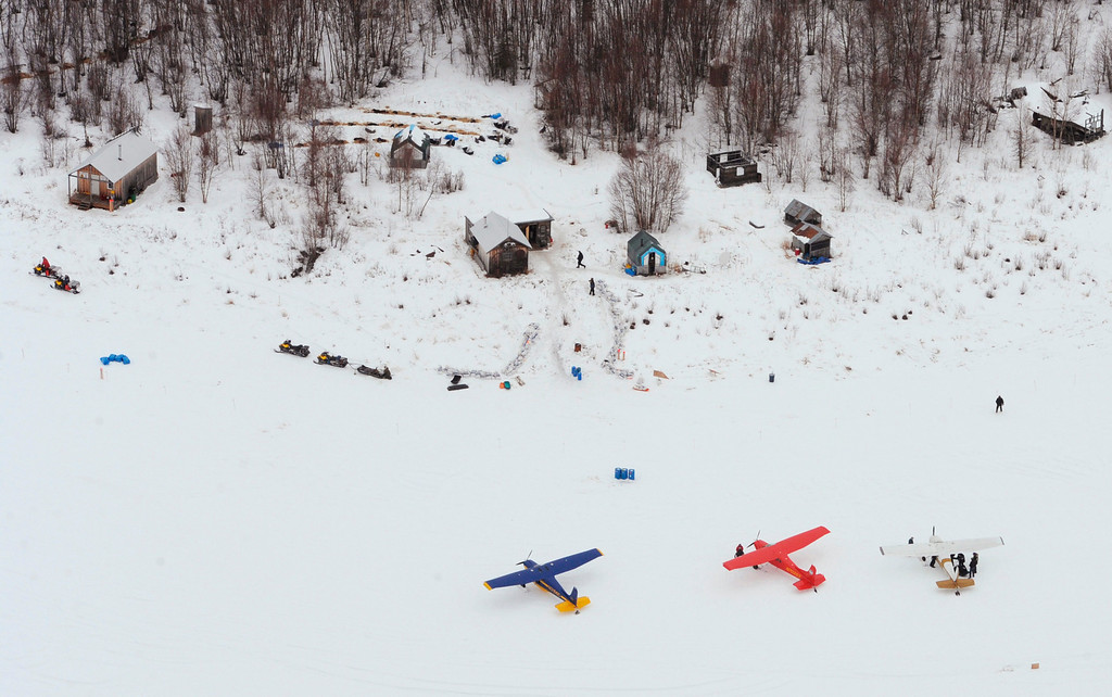 Description of . The lead group of Iditarod Trail Sled Dog Race mushers rest their dog teams in a wooded area at the historic checkpoint of Iditarod, Alaska, on Thursday, March 7, 2013. (AP Photo/Anchorage Daily News, Bill Roth)