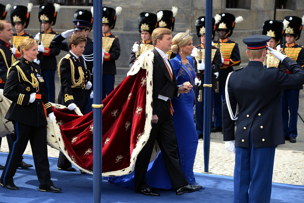 Description of . King Willem-Alexander of the Netherlands arrives with his wife Queen Maxima for his inauguration ceremony on April 30, 2013 at Nieuwe Kerk (New Church) in Amsterdam.     PATRIK STOLLARZ/AFP/Getty Images