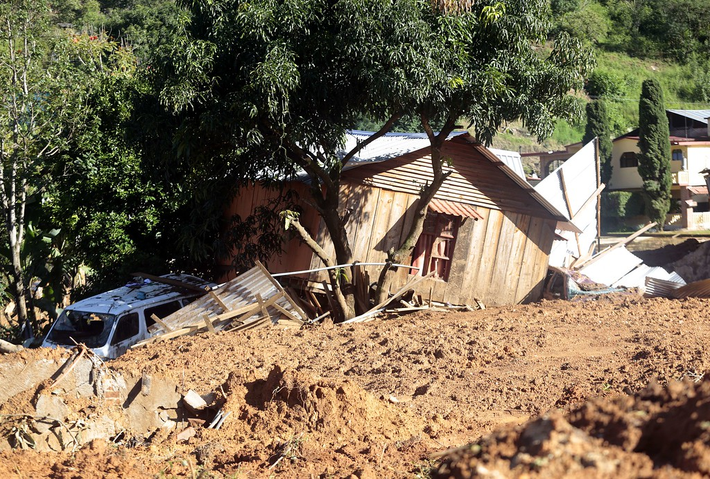 Description of . A house wrecked by a landslide at La Pintada, state of Guerrero, Mexico, on September 19, 2013 as heavy rains hit the country. AFP PHOTO/Pedro PARDO/AFP/Getty Images
