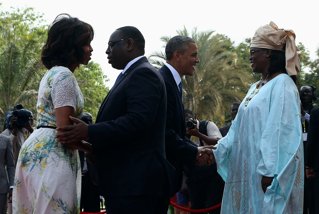 Description of . U.S. President Barack Obama (2nd R) and first lady Michelle Obama (L) are greeted by Senegal President Macky Sall (2nd L) and his wife Mariame at the Presidential Palace June 27, 2013 in Dakar, Sengal. Obama's trip, his second to the continent as president, will take him to Senegal, South Africa and Tanzania.  REUTERS/Gary Cameron