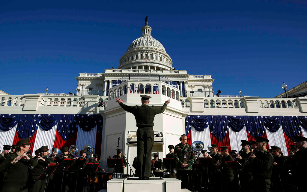 Description of . A military band conductor rehearses the Stars and Stripes on the eve of ceremonies marking the second inauguration of U.S. President Barack Obama at the U.S. Capitol in Washington, January 20, 2013.       REUTERS/Jason Reed