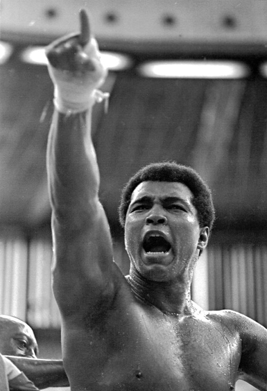 Description of . World heavyweight champion Muhammad Ali shouts
