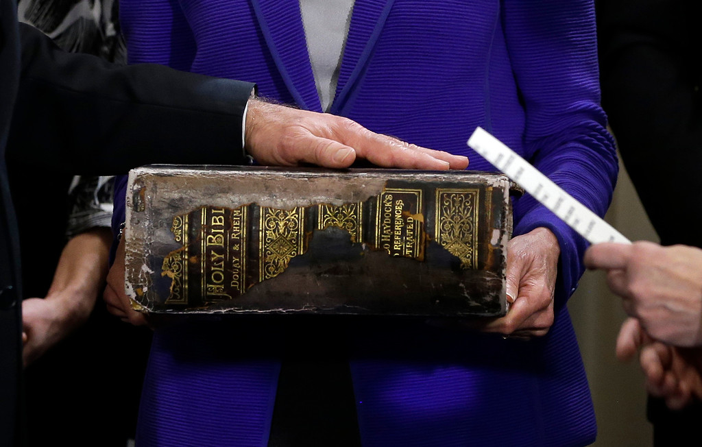 Description of . US Vice President Joe Biden (L) places his hand on the Biden family Bible held by his wife Jill Biden as he takes the oath of office from Supreme Court Justice Sonia Sotomayo during and official ceremony at the Naval Observatory on January 20, 2013 in Washington.   Carolyn KasterCarolyn Kaster/AFP/Getty Images