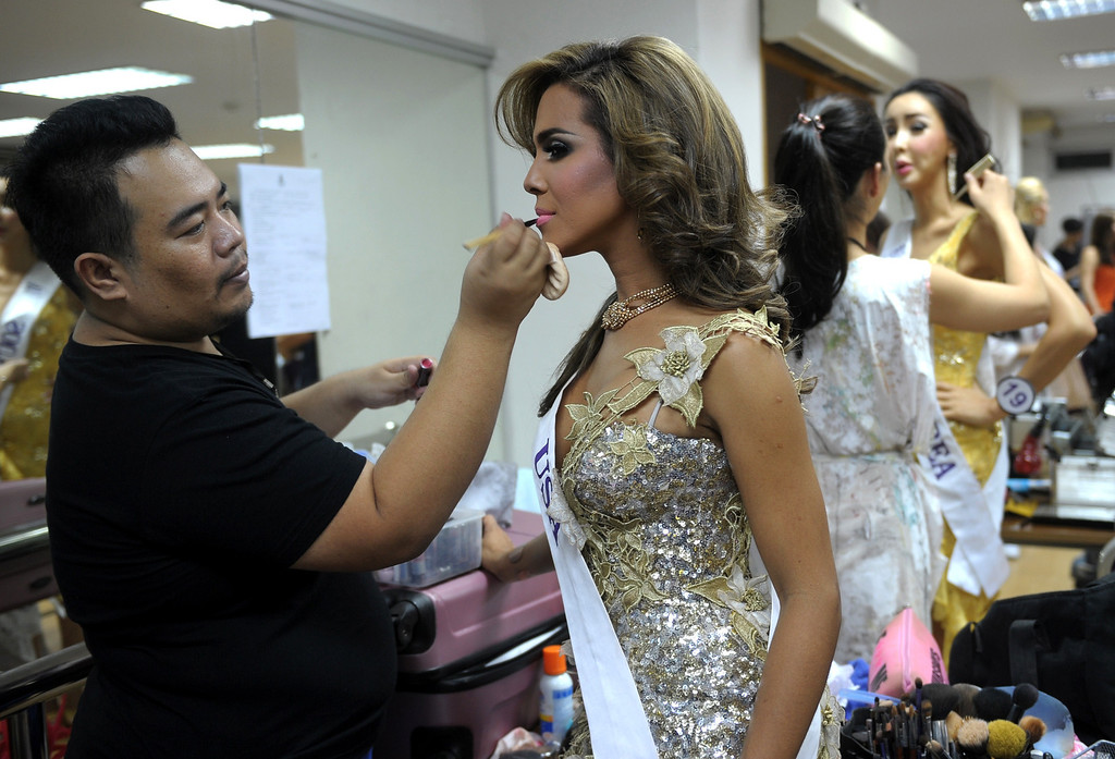 Description of . Contestants get make up at backstage during the Miss International Queen 2013 beauty contest in Pattaya resort on November 1, 2013. Twenty-five contestants from 17 countries are to compete in Pattaya for the crown of Miss International Queen since 2004. AFP PHOTO / PORNCHAI  KITTIWONGSAKUL/AFP/Getty Images