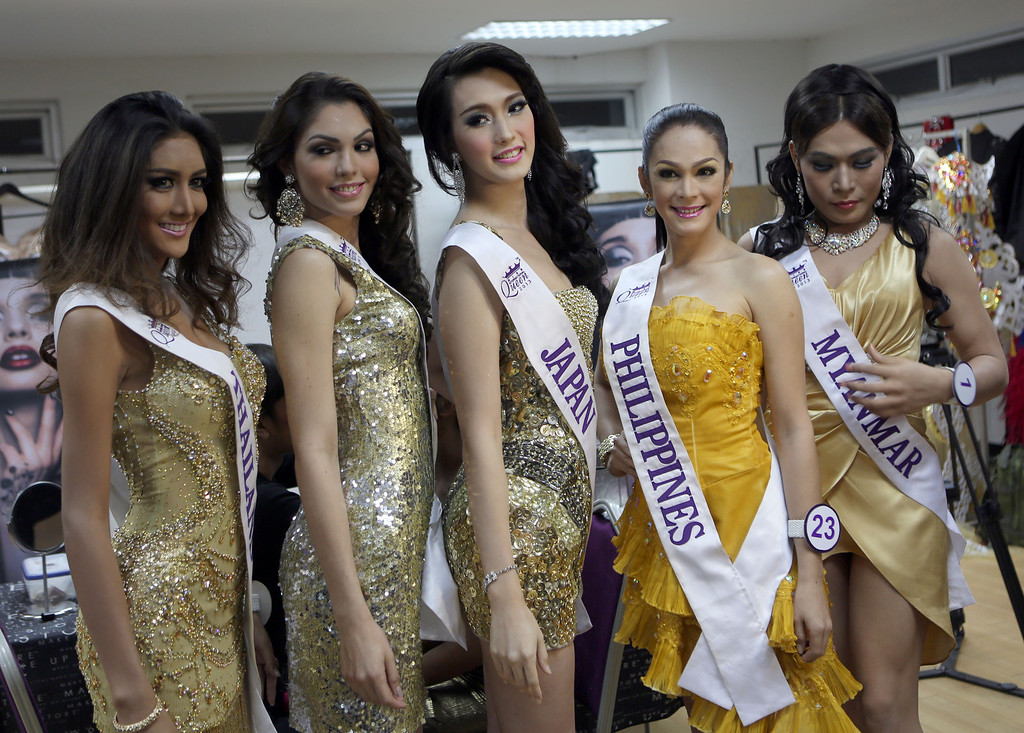 Description of . Miss International Queen 2013 transgender beauty pageant participants, from left; Nethnapada Kanrayanon of Thailand, Marcelo Ohio of Brazil, Satsuki Nishiyama of Japan, Kristina Cassandra Ybarra of the Philippines and Tanya Maung of Myanmar pose during a backstage photo at the Miss International Queen 2013 transvestite beauty pageant in Pattaya, southeastern Thailand Friday, Nov. 1, 2013. Twenty-five contestants from 17 countries participate in this year's pageant which has been held for nine respective years. (AP Photo/Apichart Weerawong)