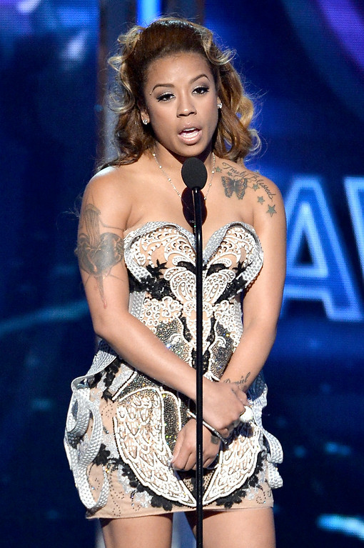Description of . Singer Keyshia Cole speaks onstage during the BET AWARDS '14 at Nokia Theatre L.A. LIVE on June 29, 2014 in Los Angeles, California.  (Photo by Kevin Winter/Getty Images for BET)