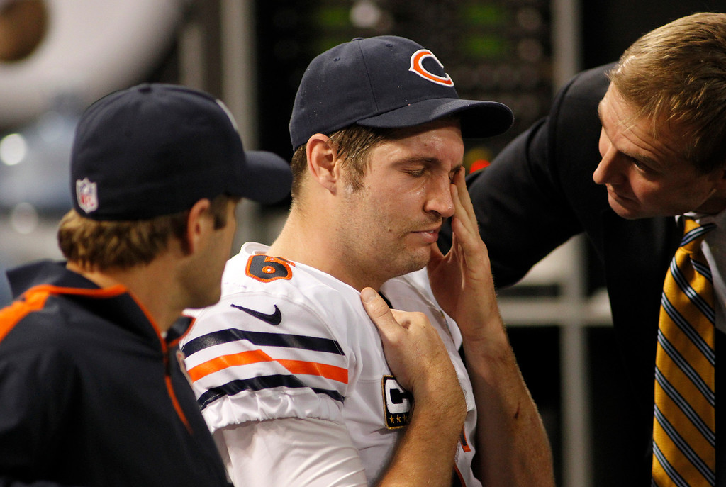 Description of . Chicago Bears quarterback Jay Cutler, center, reacts as he sits on the bench after getting injured during the second half of an NFL football game against the Minnesota Vikings Sunday, Dec. 9, 2012, in Minneapolis. (AP Photo/Andy King)