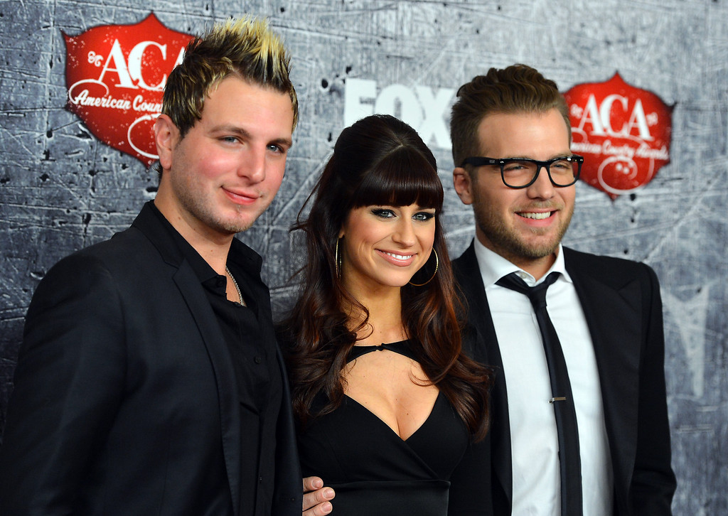 Description of . LAS VEGAS, NV - DECEMBER 10:  L-R) Mike Gossin, Rachel Reinert and Tom Gossin of Gloriana arrive at the 2012 American Country Awards at the Mandalay Bay Events Center on December 10, 2012 in Las Vegas, Nevada.  (Photo by Frazer Harrison/Getty Images)