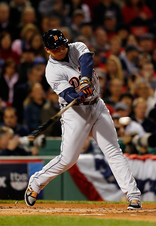 Description of . Miguel Cabrera #24 of the Detroit Tigers bats against the Boston Red Sox in the first inning of Game Two of the American League Championship Series at Fenway Park on October 13, 2013 in Boston, Massachusetts.  (Photo by Jim Rogash/Getty Images)