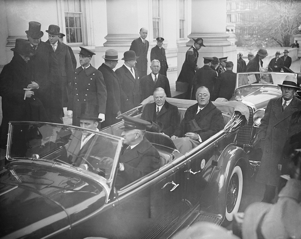 Description of . President-elect Franklin D. Roosevelt rides in a limousine with President Herbert Hoover on the way to his inauguration in 1933. (Photo from The Library of Congress)