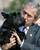 President Bush gets a firm grip on his elusive Scottish terrier Barney as he and first lady Laura Bush walk to board Air Force One, Friday, July 5, 2002, at Andrews Air Force Base, Md.  Barney sprinted across the ramp at Andrews to check out camera crews and well-wishers waiting to see the president depart for a family reunion in Kennebunkport, Maine. (AP Photo/J. Scott Applewhite)