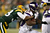 Running back Adrian Peterson #28 of the Minnesota Vikings runs the ball as he is hit by cornerback Tramon Williams #38 of the Green Bay Packers in the first quarter during the NFC Wild Card Playoff game at Lambeau Field on January 5, 2013 in Green Bay, Wisconsin.  (Photo by Jonathan Daniel/Getty Images)