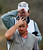 Northern Ireland's Graeme McDowell walks off the course after winning 2 up against Padraig Harrington, of Ireland, in the first round during the Match Play Championship golf tournament, Thursday, Feb. 21, 2013, in Marana, Ariz. (AP Photo/Ross D. Franklin)