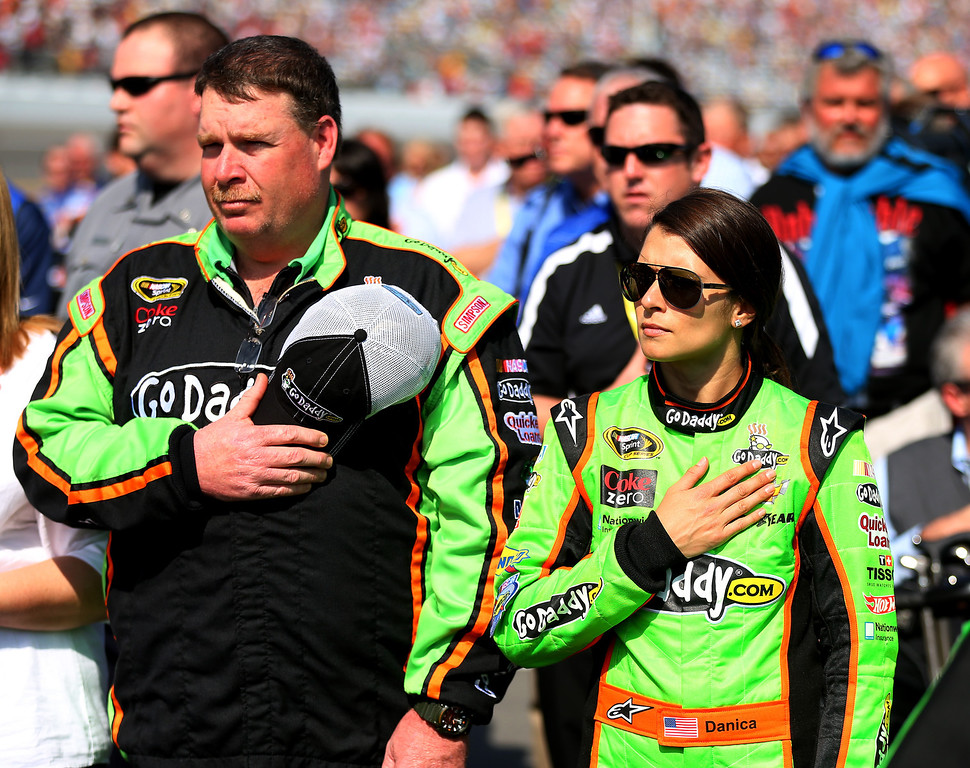 Description of . Danica Patrick, driver of the #10 GoDaddy.com Chevrolet, stands on the grid prior to the NASCAR Sprint Cup Series Budweiser Duel 1 at Daytona International Speedway on February 21, 2013 in Daytona Beach, Florida.  (Photo by Mike Ehrmann/Getty Images)