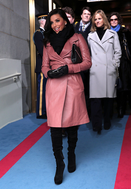 Description of . Actress Eva Longoria arrives on the West Front of the Capitol in Washington, Monday, Jan. 21, 2013, for the Presidential Barack Obama\'s ceremonial swearing-in ceremony during the 57th Presidential Inauguration.  (AP Photo/Win McNamee, Pool)