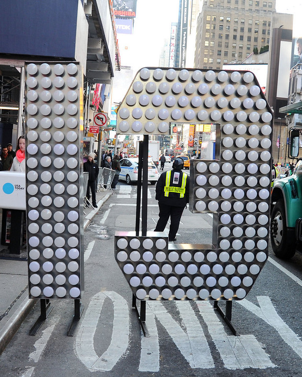 Description of . The number 13 arrives at Times Square for the 2013 New Years Eve Countdown, at Times Square on December 19, 2012 in New York City.  (Photo by Ben Gabbe/Getty Images)