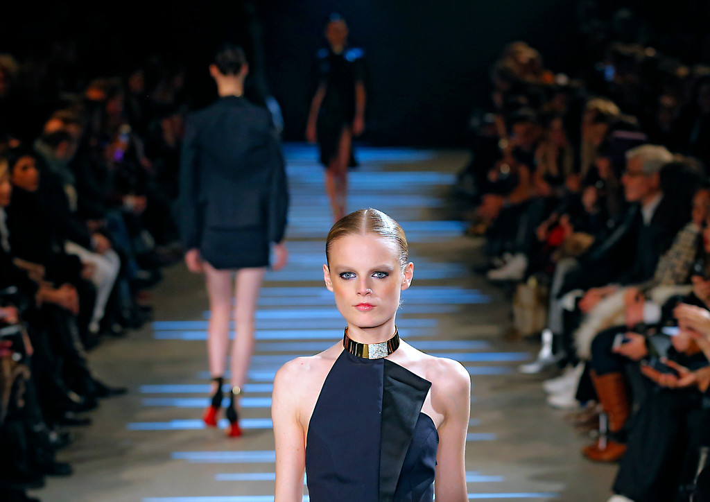 Description of . A model wears a creation by French fashion designer Alexandre Vauthier as part of the Women's Spring/Summer 2013 Haute Couture fashion collection presented in Paris, Tuesday, Jan. 22 2013 (AP Photo/ Jacques Brinon)