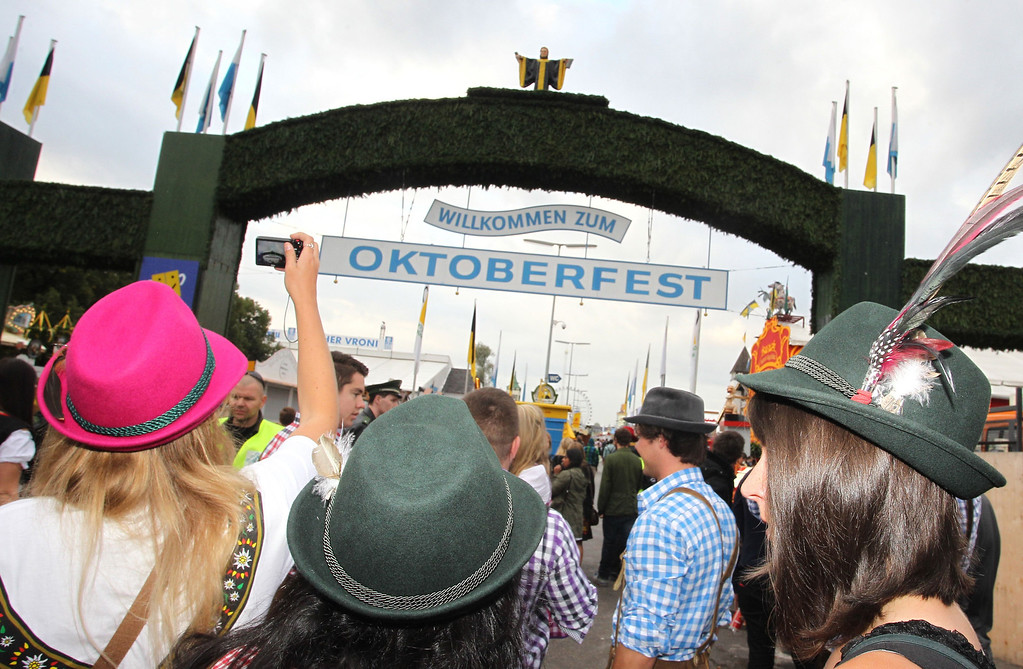 Description of . Visitors stand at the main entrance to the Oktoberfest beer festival at the Theresienwiese in Munich, southern Germany, on September 21, 2013. The world's biggest beer festival Oktoberfest will run until October 6, 2013.  AFP PHOTO / DPA / KARL-JOSEF HILDENBRAND/AFP/Getty Images