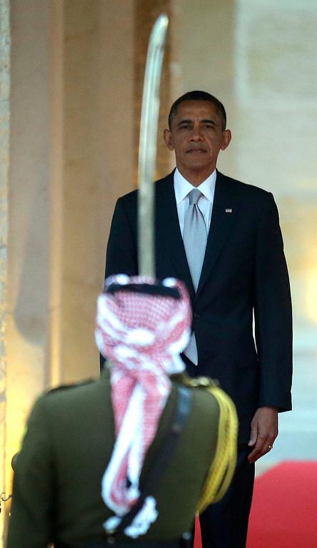 Description of . President Barack Obama participates in an arrival ceremony at Jordan King Abdullah II's  residence in Amman, Jordan Friday, March 22, 2013. (AP Photo/Pablo Martinez Monsivais)