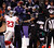 Baltimore Ravens receiver Jacoby Jones (12) fails to make a catch while defended by New York Giants cornerback Corey Webster (23) during the first half of their NFL football game in Baltimore, Maryland, December 23, 2012. REUTERS/Jonathan ErnsT