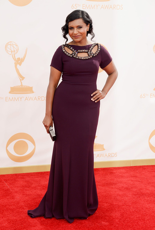 Description of . Actress Mindy Kaling arrives at the 65th Annual Primetime Emmy Awards held at Nokia Theatre L.A. Live on September 22, 2013 in Los Angeles, California.  (Photo by Frazer Harrison/Getty Images)