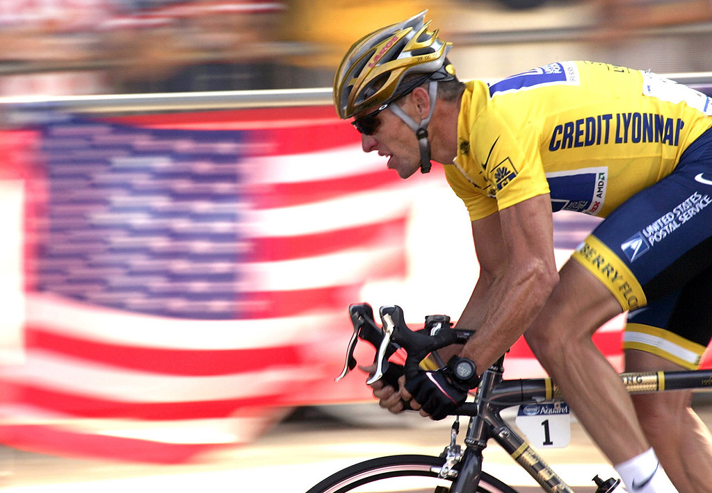 Description of . Overall leader Lance Armstrong, of Austin, Texas, rides down the Champs Elysees avenue past U.S. flags during the 20th and last stage of the Tour de France cycling race between Montereau, southeast of Paris, and the Champs-Elysees in Paris on July 25, 2004. Federal prosecutors said, Friday, Feb. 3, 2012, they are closing a criminal investigation of Armstrong and will not charge him over allegations the seven-time Tour de France winner used performance-enhancing drugs. (AP Photo/Franck Prevel, File)