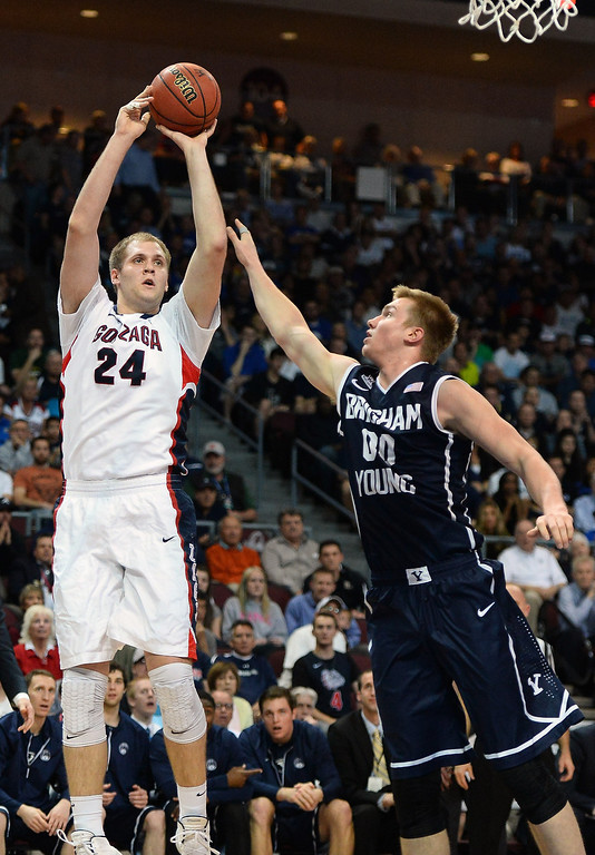 Description of . Przemek Karnowski #24 of the Gonzaga Bulldogs shoots against Eric Mika #00 of the Brigham Young Cougars during the championship game of the West Coast Conference Basketball tournament at the Orleans Arena on March 11, 2014 in Las Vegas, Nevada.  (Photo by Ethan Miller/Getty Images)