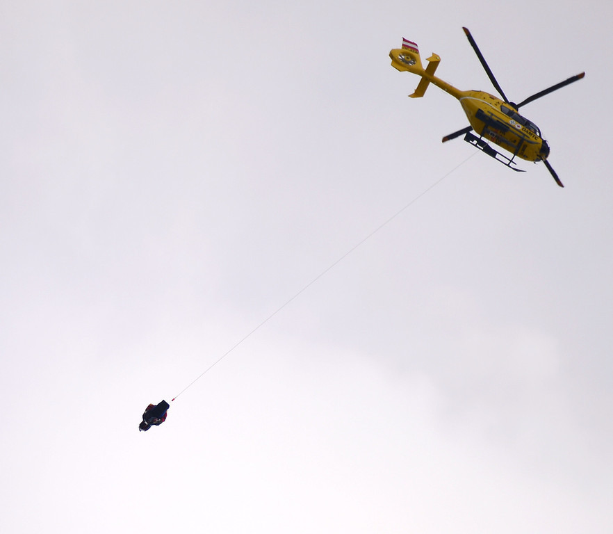 Description of . US Lindsey Vonn (bottom) is evacuated by a helicopter after falling during the women\'s Super-G event of the 2013 Ski World Championships in Schladming, Austria on February 5, 2013.  OLIVIER MORIN/AFP/Getty Images