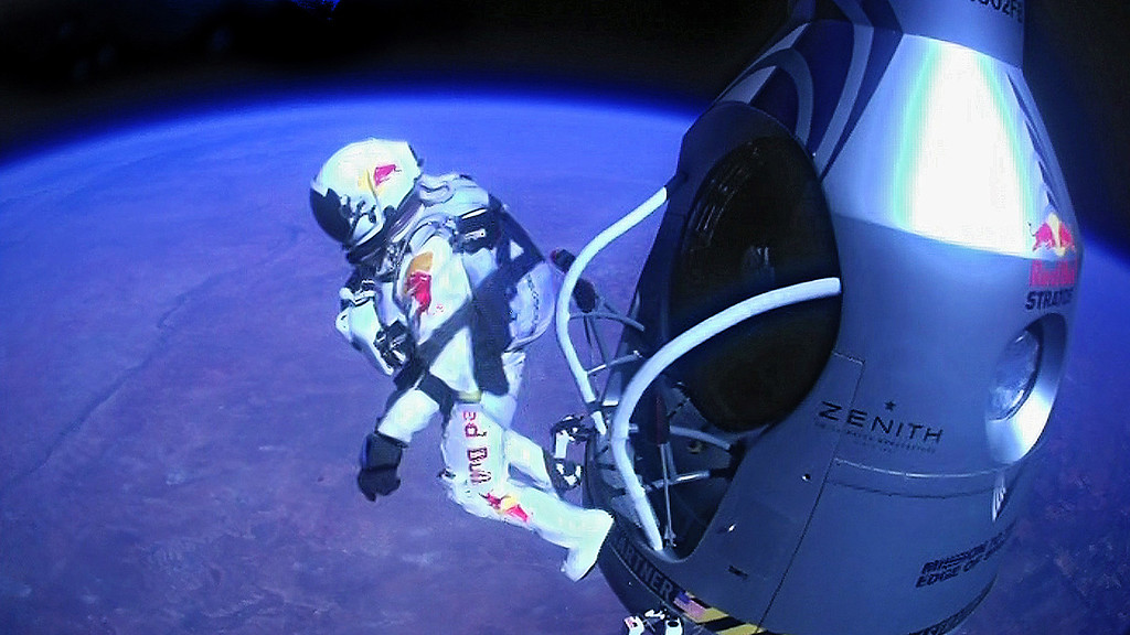 Description of . In this Oct. 14, 2012 file photo provided by Red Bull Stratos, pilot Felix Baumgartner of Austria jumps out of the capsule during the final manned flight for Red Bull Stratos. In a giant leap from more than 24 miles up, Baumgartner shattered the sound barrier while making the highest jump ever with a tumbling, death-defying plunge from a balloon to a safe landing in the New Mexico desert. (AP Photo/Red Bull Stratos, File)