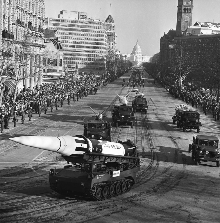 Description of . An Army Pershing missile mounted on a carrier passes along Pennsylvania Avenue in Washington during Kennedy's inaugural parade Jan. 20, 1961. Associated Press file