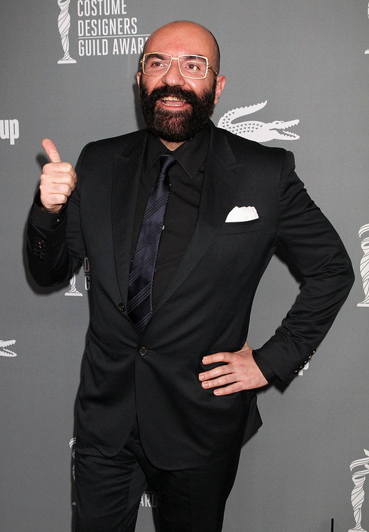""". Spanish designer Paco Delgado, Oscar nominee for Best Costume Design for \""""Les Miserables\"""" arrives at the 15th Annual Costume Designers Guild Awards in Beverly Hills  February 19, 2013.   REUTERS/Fred Prouser"""