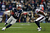 Aaron Hernandez #81 of the New England Patriots runs with the ball against Danieal Manning #38 of the Houston Texans during the 2013 AFC Divisional Playoffs game at Gillette Stadium on January 13, 2013 in Foxboro, Massachusetts.  (Photo by Elsa/Getty Images)
