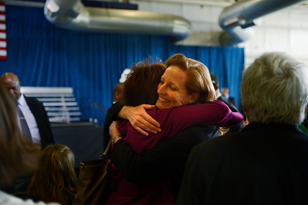Description of . DENVER, CO. - APRIL 03: Colorado State Rep Rhonda Fields is hugged by State Sen. Morgan Carroll when they meet before President Barack Obama speaks to uniformed officers and community leaders at the Denver Police Academy calling for Congress to act more like the state's Democratic-controlled legislature to pass stronger gun-control laws. (Photo By Joe Amon/The Denver Post)