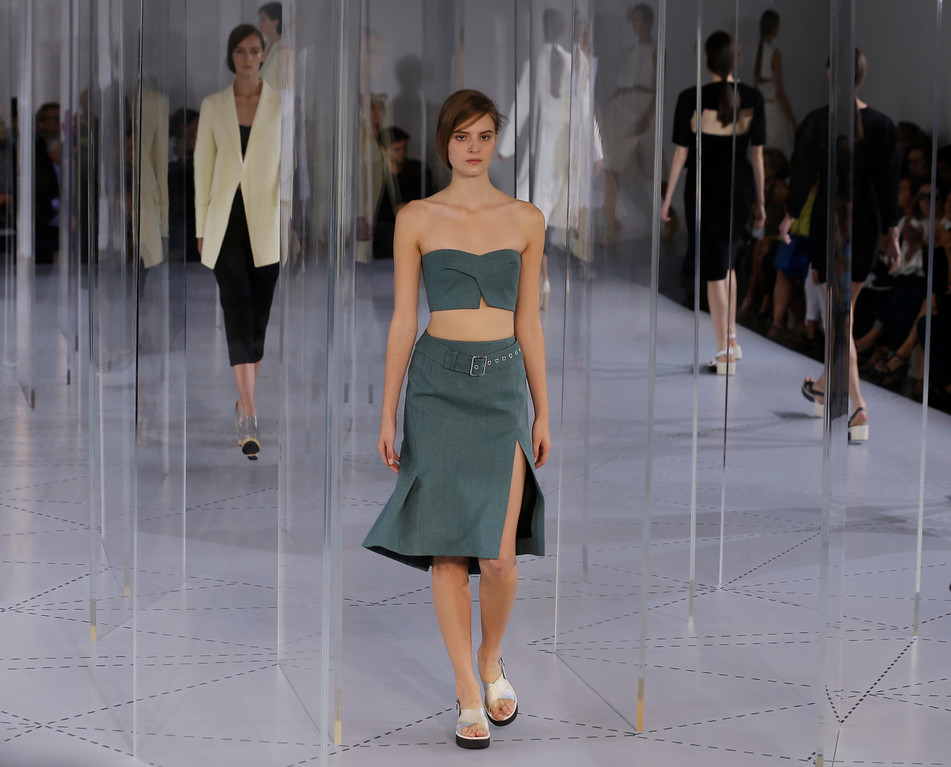 Description of . Models wear creation for Jil Sander women's Spring-Summer 2014 collection, part of the Milan Fashion Week, unveiled in Milan, Italy, Saturday, Sept. 21, 2013. (AP Photo/Luca Bruno)