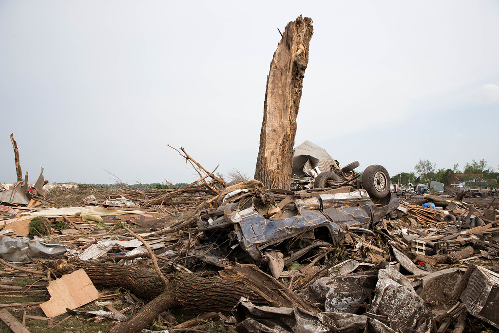 Description of . Debris is scattered along Pilger, Neb., on Monday, June 16, 2014.  The National Weather Service says the storm that struck northeast Nebraska appears to have produced four tornadoes, one of which ravaged the town of Pilger.   (AP Photo/The World-Herald, Ryan Soderlin)