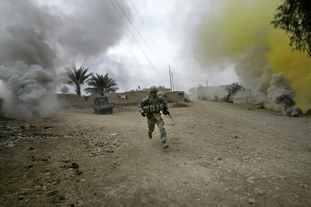 Description of . A U.S. army soldier from Ghostrider Company, 3rd Squadron, 2nd Stryker Cavalry Regiment runs for cover during Operation Phantom Phoenix in the village of Abu Musa on the northern outskirts of Muqdadiyah, in the volatile Diyala province, about 90 kilometers (60 miles) north of Baghdad, Iraq, Thursday, Jan. 10, 2008. (AP Photo/Marko Drobnjakovic)