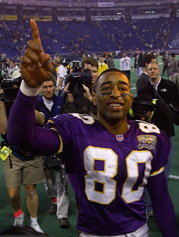 Description of . 06 Jan 2001:  Wide receiver Cris Carter #80 of the Minnesota Vikings celebrates after defeating the New Orleans Saints at the Metrodome in Minneapolis, Minnesota.   The Vikings won 34-16 to advance to the NFC Championship.  Mandatory Credit: Brian Bahr/ALLSPORT