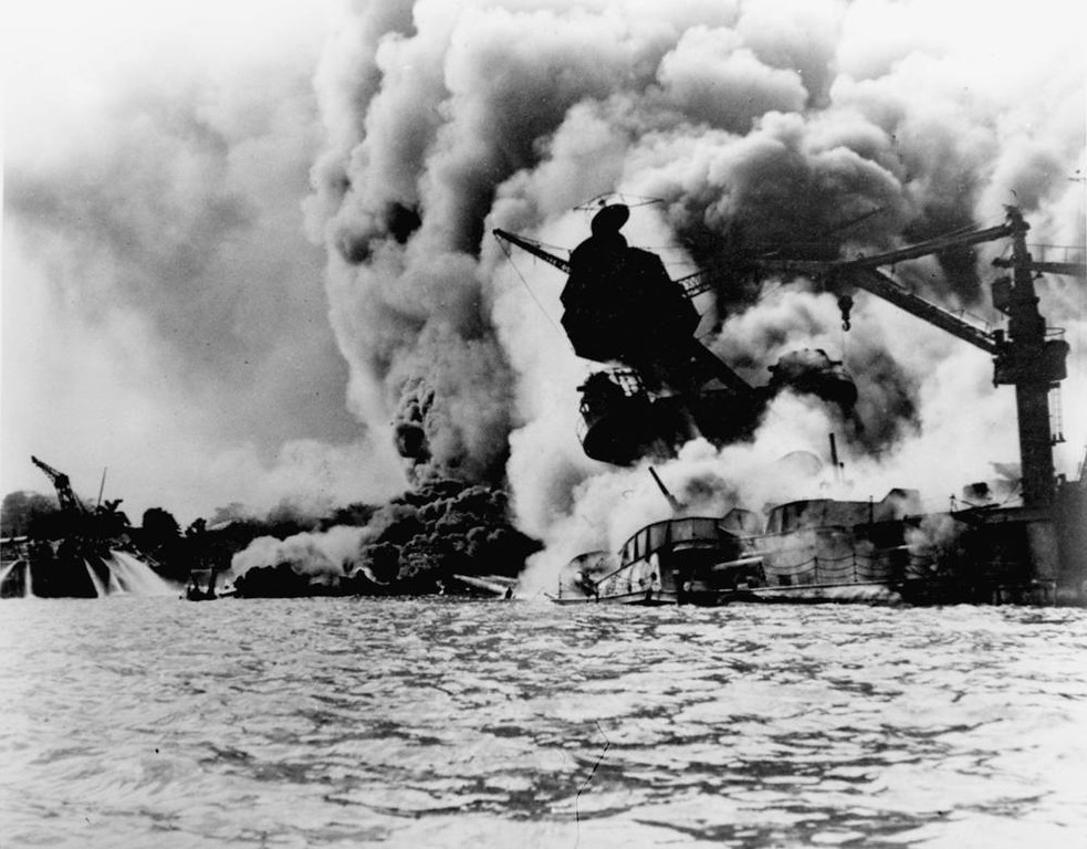 Description of . This photo shows the Japanese attack on Pearl Harbor on December 7, 1941.  The USS Arizona is pictured in flames after the attack.  (AP Photo/U.S. Navy)