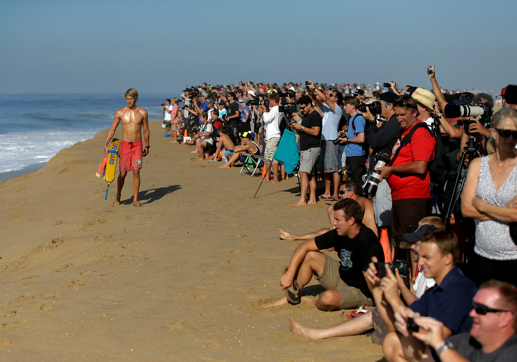 Description of . A lifeguard watches surfers ride waves at the wedge on Wednesday, Aug. 27, 2014 in Newport Beach, Calif. Beach goers experienced much higher than normal surf, brought on by Hurricane Marie spinning off the coast of Mexico. (AP Photo/Chris Carlson)