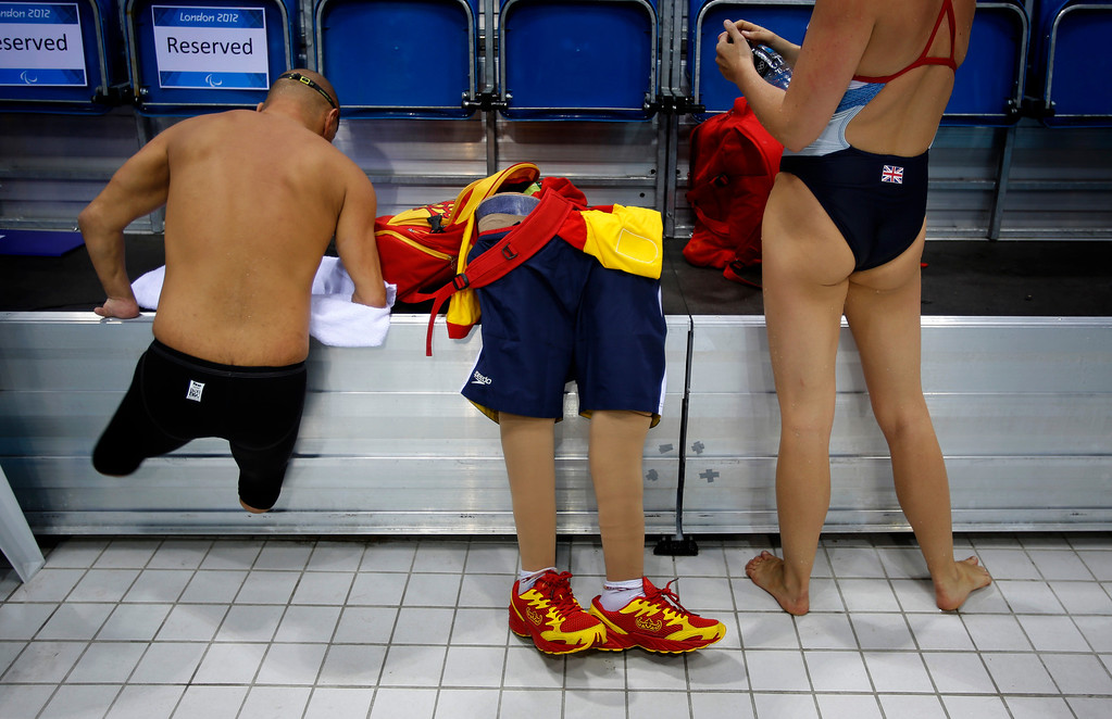 Description of . In this Aug. 31, 2012 file photo, Spain's Xabi Torres jumps next to his prosthesis as he leaves the swimming pool after training ahead of the competition at the 2012 Paralympics Olympics in London. (AP Photo/Emilio Morenatti, File)