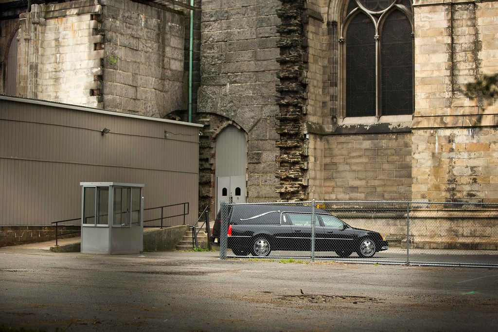 Description of . A hearse arrives outside the Cathedral Church of Saint John the Divine for the funeral services of James Gandolfini, in New York June 27, 2013.  REUTERS/Lucas Jackson