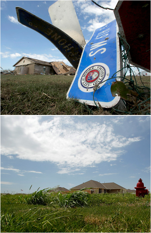 Description of . In this photo combination, a tornado-ravaged home stands in the distance beyond a twisted street sign on May 22, 2013, in Moore, Okla., top, and the lot is cleared and a new homes stand next door on May 8, 2014, bottom. Moore continues to rebuild in the wake of a massive tornado that tore through Oklahoma City suburb on May 20, 2013. (AP Photo/Charlie Riedel)