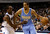 Denver Nuggets point guard Andre Miller (24) attempts to get by Dallas Mavericks' Rodrigue Beaubois, of Guadeloupe, in the first half of an NBA basketball game on Friday, Dec. 28, 2012, in Dallas. (AP Photo/Tony Gutierrez)