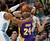 Los Angeles Lakers guard Kobe Bryant, front right, is fouled while driving for a shot by Denver Nuggets center Kosta Koufos, back right, as guard Andre Iguodala comes in to cover in the third quarter of the Nuggets' 119-108 victory in an NBA basketball game in Denver on Monday, Feb. 25, 2013. (AP Photo/David Zalubowski)