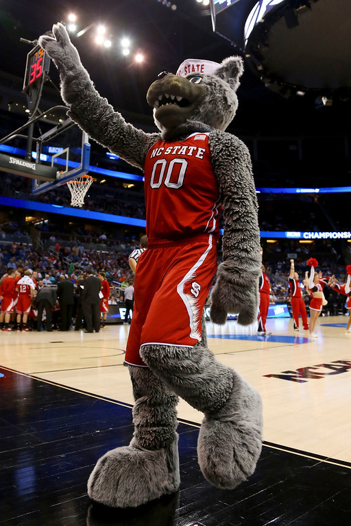 Description of . North Carolina State Wolfpack mascot cheers against the Saint Louis Billikens during the second round of the 2014 NCAA Men's Basketball Tournament at Amway Center on March 20, 2014 in Orlando, Florida.  (Photo by Mike Ehrmann/Getty Images)