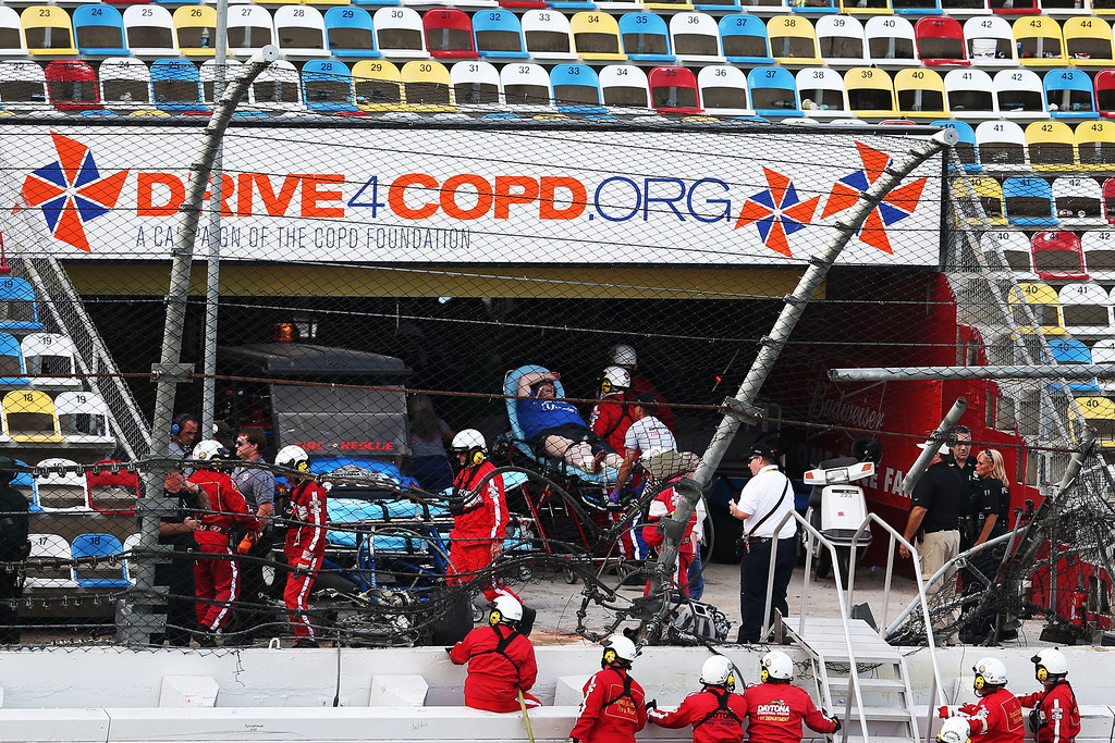 Description of . DAYTONA BEACH, FL - FEBRUARY 23:  Medical personnel remove an injured fan from the stands following an incident at the finish of  the NASCAR Nationwide Series DRIVE4COPD 300 at Daytona International Speedway on February 23, 2013 in Daytona Beach, Florida.  (Photo by Matthew Stockman/Getty Images)