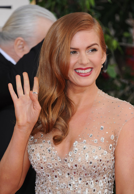 Description of . Actress Isla Fisher arrives at the 70th Annual Golden Globe Awards at the Beverly Hilton Hotel on Sunday Jan. 13, 2013, in Beverly Hills, Calif. (Photo by Jordan Strauss/Invision/AP)