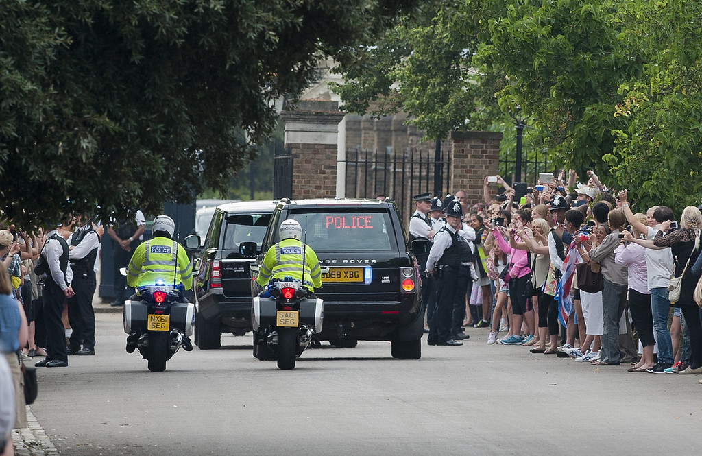 Description of . Prince William drives Catherine, Duchess of Cambridge and their new-born baby boy back to Kensington Palace in London on July 23, 2013. The baby was born on Monday afternoon weighing eight pounds six ounces. The royal couple have led a relatively simple married life until now at a farmhouse in Wales close to William\'s airbase, though after the birth they will move into London\'s Kensington Palace, which has been refurbished at a cost of £1 million of British taxpayers\' money.  WILL OLIVER/AFP/Getty Images